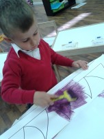 boy painting purple prickles