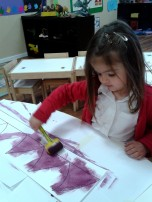 girl painting purple prickles