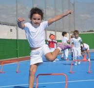 girl doing hurdles