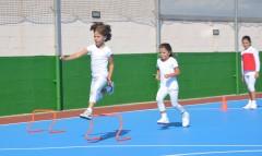 girl jumping hurdle