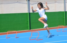 girl leaping hurdles